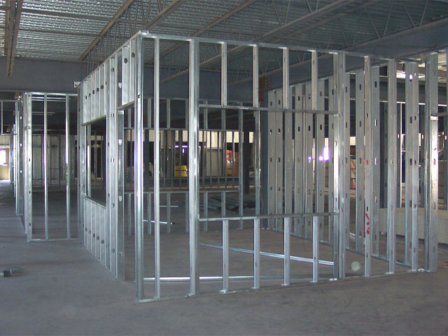 office renovation in an existing warehouse metal stud construction soundproofing insulation and drywall - Metal Studs Framing